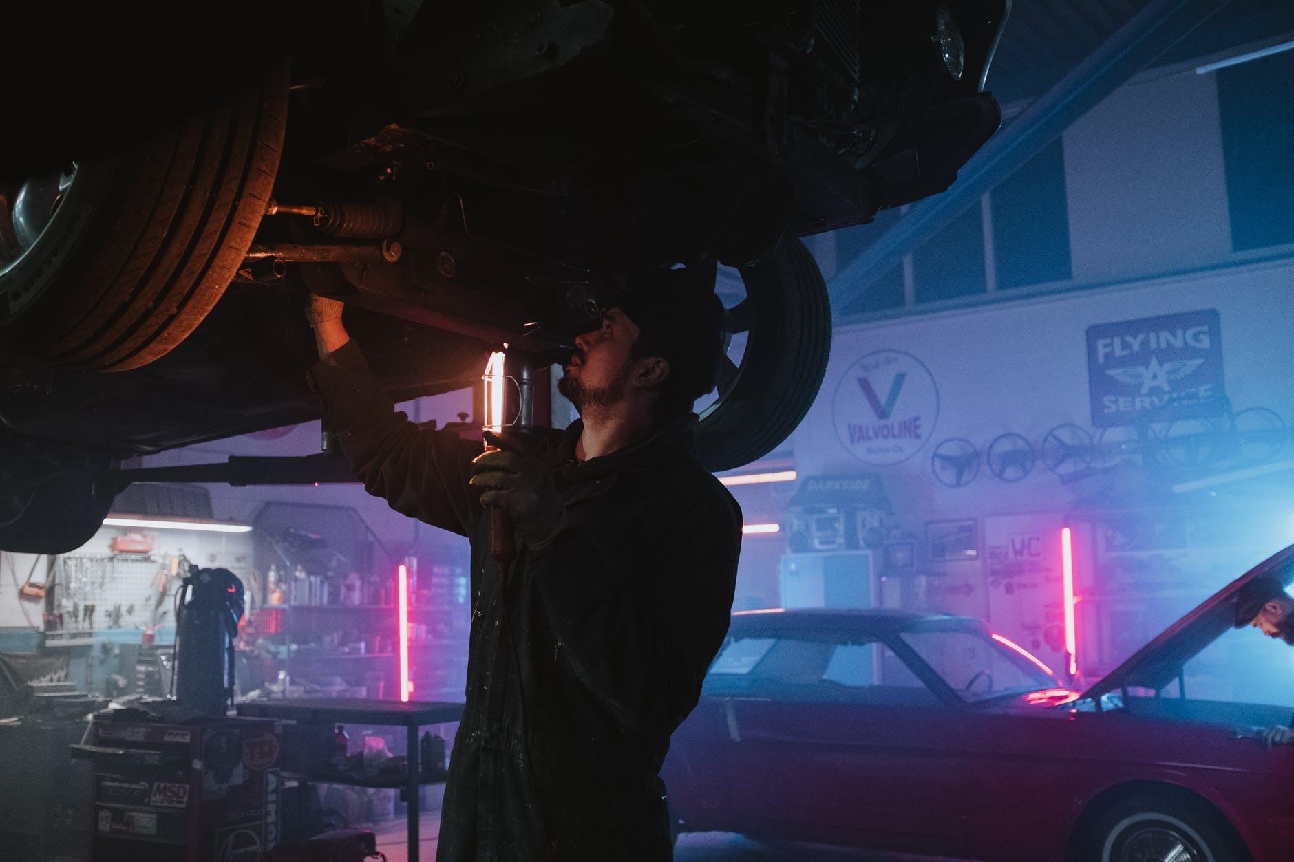 Photo of a mechanic repairing a car.