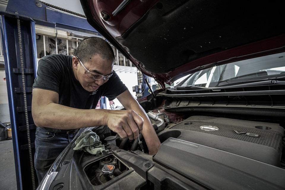 Photo of a mechanic working on an auto repair job.